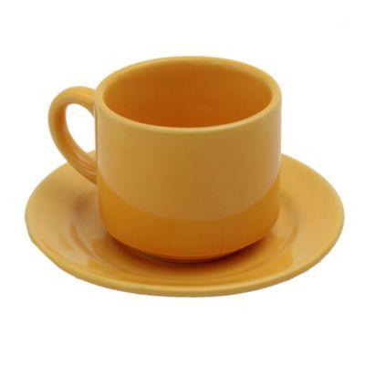 Taza de te con plato amarillo