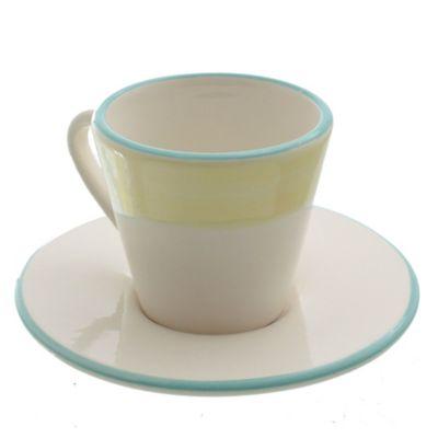Taza café con plato de cerámica amarillo